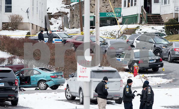 12/15/17 Wesley Bunnell | Staff State and New Britain Police on Friday morning at the intersection of Chapman St and Chapman Ct where an officer involved shooting occurred on Thursday evening involving three suspects in a green Toyota. State Police gather evidence around the scene.
