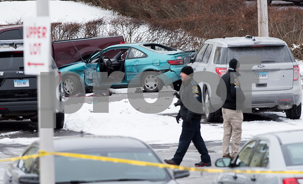 12/15/17 Wesley Bunnell | Staff State and New Britain Police on Friday morning at the intersection of Chapman St and Chapman Ct where an officer involved shooting occurred on Thursday evening involving three suspects in a green Toyota. State Police collect evidence around the scene.