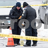 12/15/17  Wesley Bunnell | Staff<br /> <br /> State and New Britain Police on Friday morning at the intersection of Chapman St and Chapman Ct where an officer involved shooting occurred on Thursday evening involving three suspects in a green Toyota.