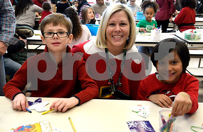 12/16/2017 Mike Orazzi | Staff Principal Karen Falvey with James Roby,8, and Christopher Arroyo,6, at the Smith Elementary School's Breakfast with Santa on Saturday morning in New Britain.