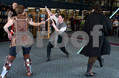12/16/2017 Mike Orazzi | Staff Granite State Saber Academy's and Kristal Terpstra, Adrian Johnson and Dan DuBois during a lightsaber battle at the Star Wars event at the Southington Public Library Saturday afternoon.