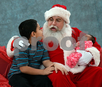 12/16/2017 Mike Orazzi | Staff Samuel,7, and his sister Jackbrielys Astacio, 16 days,at the Smith Elementary School's Breakfast with Santa on Saturday morning in New Britain.
