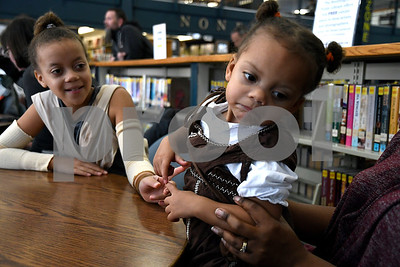 12/16/2017 Mike Orazzi | Staff Sisters Aydia,11, and Beayta Burgos,2, in costume during a Star Wars event at the Southington Public Library Saturday afternoon.