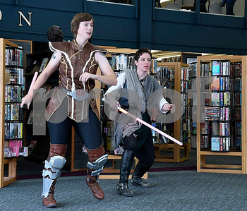 12/16/2017 Mike Orazzi | Staff Granite State Saber Academy's and Kristal Terpstra and Adrian Johnson during a lightsaber battle at the Star Wars event at the Southington Public Library Saturday afternoon.