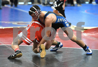 12/16/2017 Mike Orazzi | Staff Bristol Eastern's Tom Nichols and Berlin's Josh Bois during a 127 match at the CJ McCormack Memorial Tournament at Berlin High School Saturday morning.