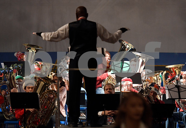 12/16/2017 Mike Orazzi | Staff Walter Gibson while conducting the New Britain TubaChristmas held at Trinity on Main Saturday afternoon.