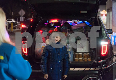 12/18/17  Wesley Bunnell | Staff  The Bristol Police Explorers held a stuff the cruiser toy and clothing drive on Monday night outside of Walmart in Bristol. Madelyn McGrane , age 9, smiles as she looks back at her mother standing in front of a police cruiser after making a donation.