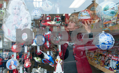 12/18/17  Wesley Bunnell | Staff  Owner Krystyna Ovara of Quo Vadis gift shop on Broad Street arranges Christmas decorations in the store front window on Monday afternoon.