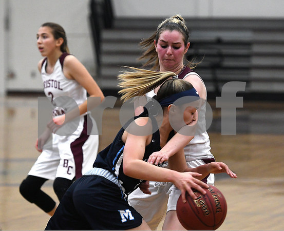 12/19/2017 Mike Orazzi   Staff Bristol Central's Sarah Guerin (22) and Middletown's Amanda Fudge (2) during Tuesday night's girls basketball game at BC.