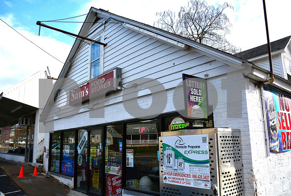 12/19/2017 Mike Orazzi | Staff The Sam's Food Store, at 259 West Washington St., after a lone male demanded money while armed with a knife and fled the store with an unreleased amount of money.