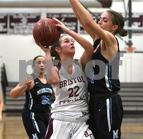 12/19/2017 Mike Orazzi | Staff Bristol Central's Sarah Guerin (22) and Middletown's Mackenzie Dunn (25) during Tuesday night's girls basketball game at BC.