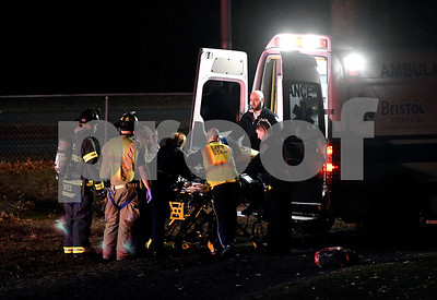 12/19/2017 Mike Orazzi | Staff The driver of a Jeep is loaded on to LifeStart after a one vehicle crash on Willis Street near the Wolcott line in Bristol Tuesday evening at the Memorial Blvd. School.