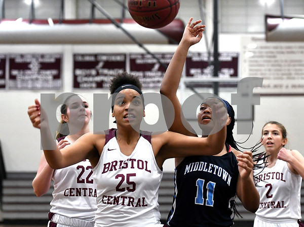 12/19/2017 Mike Orazzi | Staff Bristol Central's Xia'ian Carrasco (25) and Middletown's Dominique Highsmith (11) during Tuesday night's girls basketball game at BC.