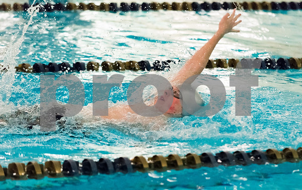 12/19/17 Wesley Bunnell   Staff Newington boys swimming defeated Manchester 94-69 on Tuesday afternoon at Newington High School. Sean Abrams of Newington competes in the 100m backstroke.