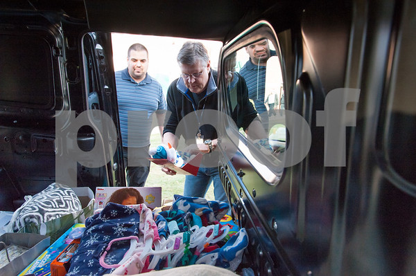 12/20/17 Wesley Bunnell | Staff Papas Dodge delivered donations to the Prudence Crandall Center on Wednesday afternoon as part of its fill the van drive held over the last several weeks. Household items were collected at the dealership such as bedding, clothes, small appliances and other household necessities clients of the center who are victims of domestic violence. Prudence Crandall's Randy Martin, R, looks over items to be carried in.