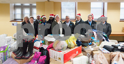 12/20/17  Wesley Bunnell | Staff  Papa's Dodge delivered donations to the Prudence Crandall Center on Wednesday afternoon as part of its fill the van drive held over the last several weeks.  Household items were collected at the dealership such as bedding, clothes, small appliances and other household necessities clients of the center who are victims of domestic violence. Prudence Crandall Center Development Director Carolyn Jasper, Executive Director Barbara Damon, General Manager Sean Lawlor, Detail Department Supervisor Eugenio Rosario, Quaid Collomore, Receptionist Brianna Emmendover, Service and Parts Director Phil Vetre,  Parts Assistant Manager Tom Shirley,  Body Shop Manager Marty Mattei and Jordan McMahon.