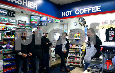 12/20/2017 Mike Orazzi | Staff Naqvi brothers talk about the robbery of the Valero Gas station on Pine Street near the Plainville town line in Bristol Wednesday afternoon.