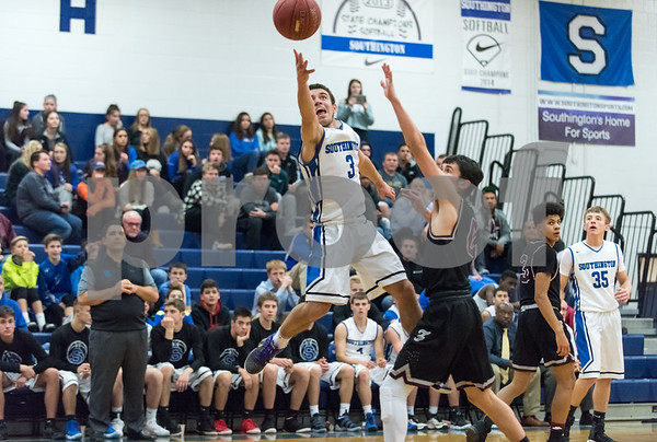 12/21/17 Wesley Bunnell | Staff Southington basketball defeated Farmington on Thursday night at Southington High School. Colin Burdette (3).