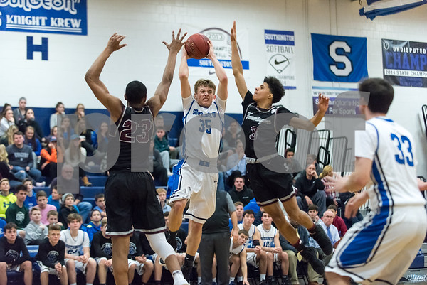 12/21/17 Wesley Bunnell | Staff Southington basketball defeated Farmington on Thursday night at Southington High School. Andrew Lohneiss (35).