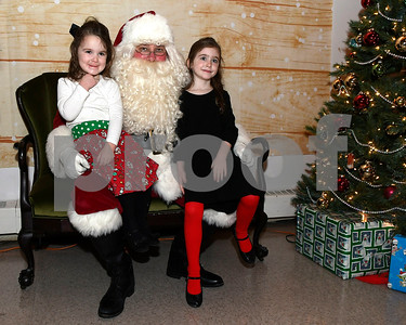 12/2/2017 Mike Orazzi | Staff Piper and Claire Carmody,2 and 5 with Santa during the 24th Annual Breakfast with Santa at Giamatti Little League Center Saturday morning.