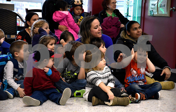 12/21/2017 Mike Orazzi | Staff Children listen to the Northeast Middle School Tigers Wind Ensemble perform during a Christmas concert at theImagine Nation, A Museum Early Learning Center Thursday afternoon.