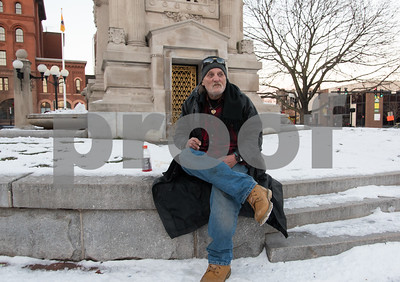 12/26/17  Wesley Bunnell | Staff  Lifelong New Britain resident Rodney Houston, who is currently homeless, sits in a snowy and frigid Central Park on Tuesday afternoon as he makes plans to avoid the bitter cold expected in the area for the next few days.