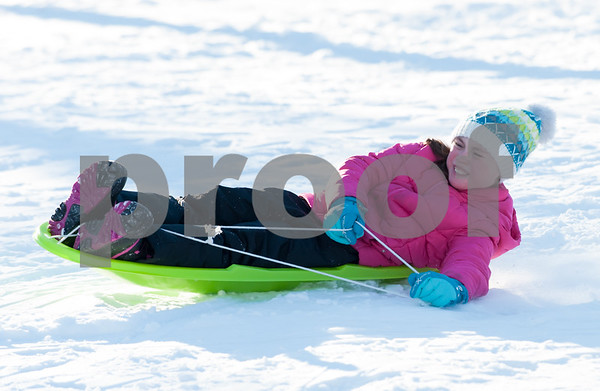 12/26/17 Wesley Bunnell | Staff Families took advantage of good sledding conditions at Page Park on Tuesday afternoon. Kyleigh Setula , age 10, fights to steer her sled.