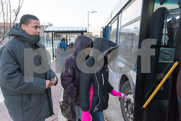 12/26/17 Wesley Bunnell | Staff Armando Rivera, Daramis Ortiz and Darimir Rivera are bundled up while waiting to board a CTfastrak bus on Tuesday afternoon in downtown New Britain.