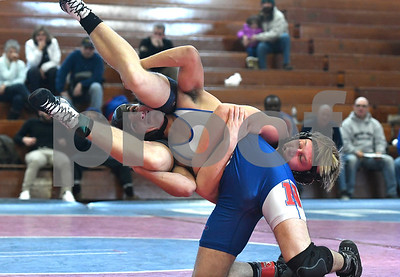 12/28/2017 Mike Orazzi | Staff St. Paul's Johann Strasser and Nonnewaug's Mason Abraham in the 145 wrestling match at St. Paul Thursday.