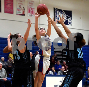 12/28/2017 Mike Orazzi | Staff Plainville's Jaida Vasquez (5) and SMSA's Julia Beebe (23) and Tatiana Stokes  (21) during the Rybczyk Memorial Holiday Basketball Tournament at Plainville High School Thursday afternoon.
