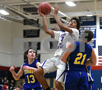 12/28/2017 Mike Orazzi | Staff Plainville's Pierre Ramirez (3)  during the Rybczyk Memorial Holiday Basketball Tournament at Plainville High School Thursday afternoon
