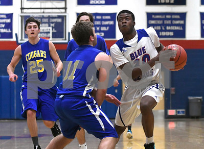 12/28/2017 Mike Orazzi | Staff Plainville's Dane Stephens (30) and HK's Jackson Parmentier (11) during the Rybczyk Memorial Holiday Basketball Tournament at Plainville High School Thursday afternoon.