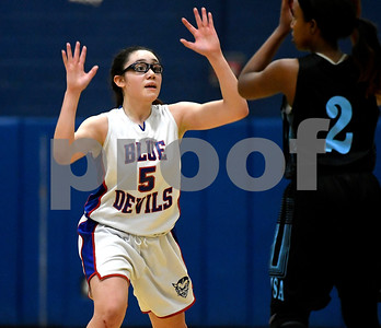12/28/2017 Mike Orazzi | Staff Plainville's Jaida Vasquez (5) and SMSA's Kalissa Jameson (22) during the Rybczyk Memorial Holiday Basketball Tournament at Plainville High School Thursday afternoon.