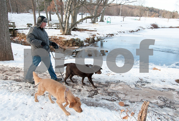 12/29/17 Wesley Bunnell | Staff Neil Ouellette of New Britain walks his labs Shelby, L, and Duke in a frigid Stanley Quarter Park on Friday afternoon with temperatures in the teens.