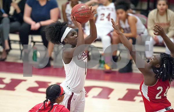 12/29/17 Wesley Bunnell | Staff New Britain basketball was defeated by visiting Wilbur Cross 56-28 on Friday evening at New Britain High School. Inanna Rice (1) shoots.