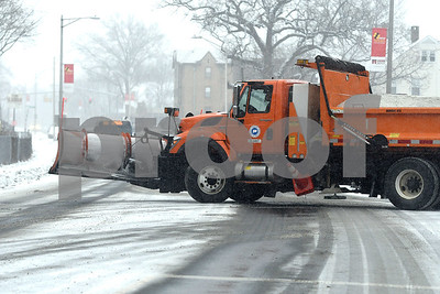 12/30/2017  Mike Orazzi | Staff A state plow truck on West Main Street in New Britain during Saturday's snow storm.