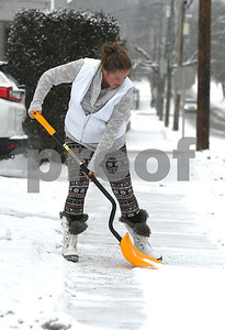 12/30/2017  Mike Orazzi | Staff Lisa Kawecki while shoveling snow from a sidewalk along Carlton Street in New Britain Saturday.