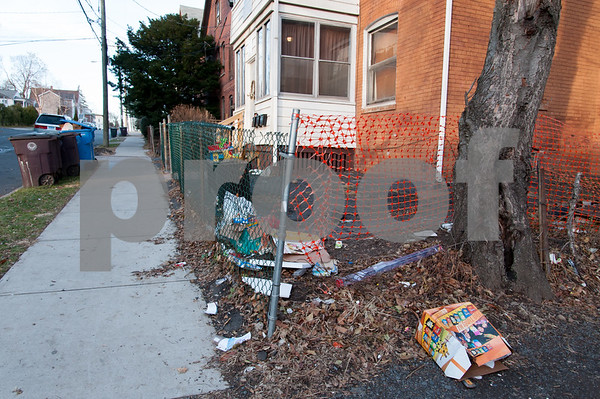 12/06/17 Wesley Bunnell | Staff Trash and other items between 11 and 13 Tremont St in the North Oak Section of New Britain. Residents of the neighborhood have recently been speaking up regarding blight and alleged neglect from the city regarding their concerns.
