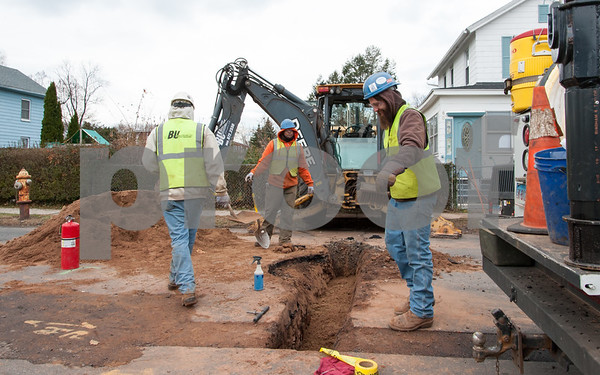 12/06/17 Wesley Bunnell | Staff Workers from Barber Utilities work on an underground gas line on Oak St on Wednesday morning.