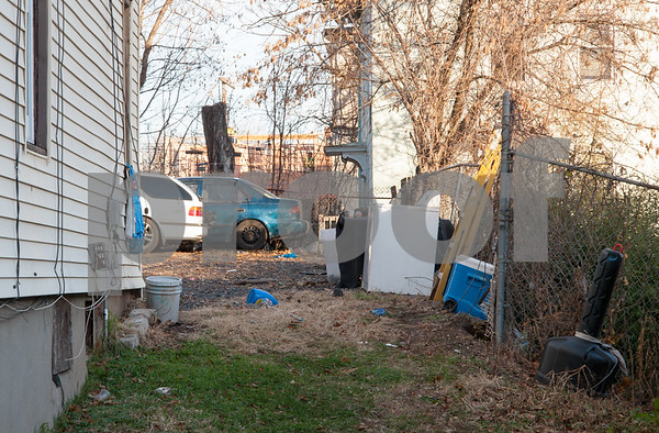 12/06/17 Wesley Bunnell | Staff Trash and other items on the side of 11 Tremont St in the North Oak Section of New Britain. Residents of the neighborhood have recently been speaking up regarding blight and alleged neglect from the city regarding their concerns.