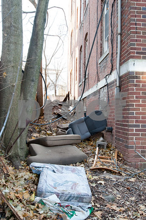 12/06/17 Wesley Bunnell | Staff Trash and other items on the side of 24 Tremont St in the North Oak Section of New Britain. Residents of the neighborhood have recently been speaking up regarding blight and alleged neglect from the city regarding their concerns.