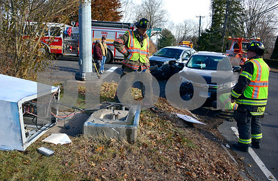 12/6/2017 Mike Orazzi | Staff The scene of a two-car crash at the intersection of Central and Washington Streets in the Forestville section of Bristol Wednesday afternoon. One person was transported from the scene.
