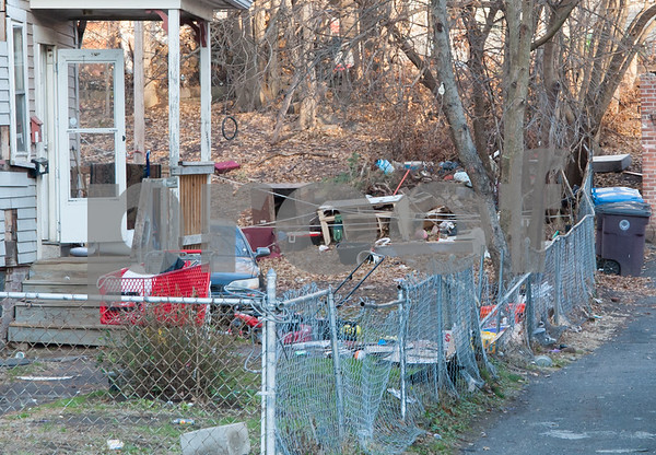 12/06/17 Wesley Bunnell | Staff Trash and other items on the side and rear of 29 Tremont St in the North Oak Section of New Britain. Residents of the neighborhood have recently been speaking up regarding blight and alleged neglect from the city regarding their concerns.