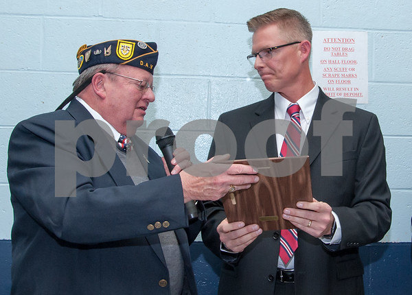 12/07/17 Wesley Bunnell | Staff The VFW of New Britain held their annual officer installation and award ceremony on Thursday evening. Patriotic teacher of the year Steve Collins, R, receives his award from VFW President Thomas Higgins.