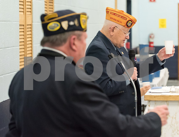 12/07/17 Wesley Bunnell | Staff The VFW of New Britain held their annual officer installation and award ceremony on Thursday evening. A toast is raised during a ceremony to honor POW and MIA.