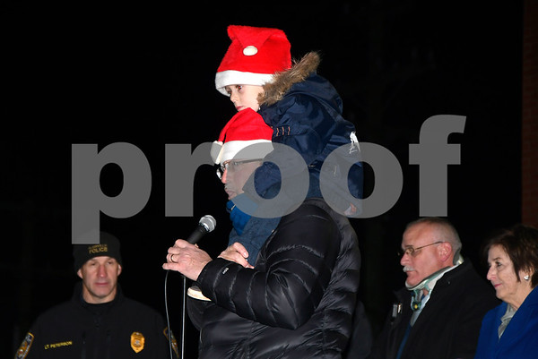 12/8/2017 Mike Orazzi | Staff State Rep Bill Petit and his son Bill during the annual tree lighting held at the Plainville Fire Department Friday evening.