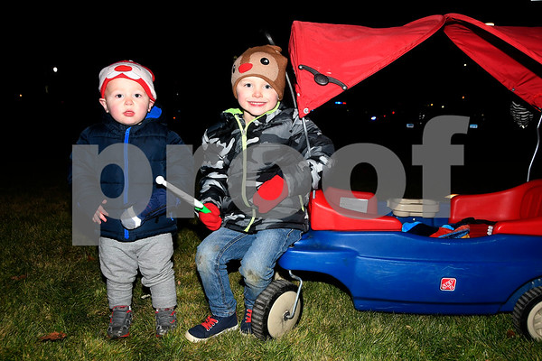 12/8/2017 Mike Orazzi   Staff Brothers Erickson and Easton Butkus, 1 and 4, during the annual tree lighting held at the Plainville Fire Department Friday evening.