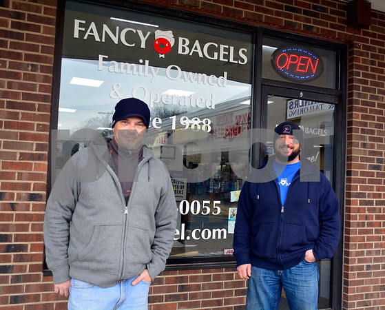 12/8/2017 Mike Orazzi | Staff Fancy Bagels' Sal Belcaro and Dominick Gualtieri in Southington Friday.