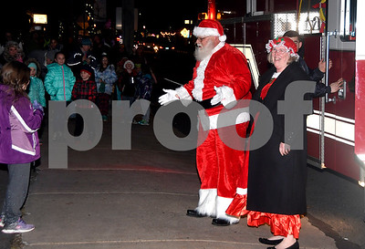 12/8/2017 Mike Orazzi   Staff Santa and Mrs Claus arrive on a fire truck during the annual tree lighting held at the Plainville Fire Department Friday evening.