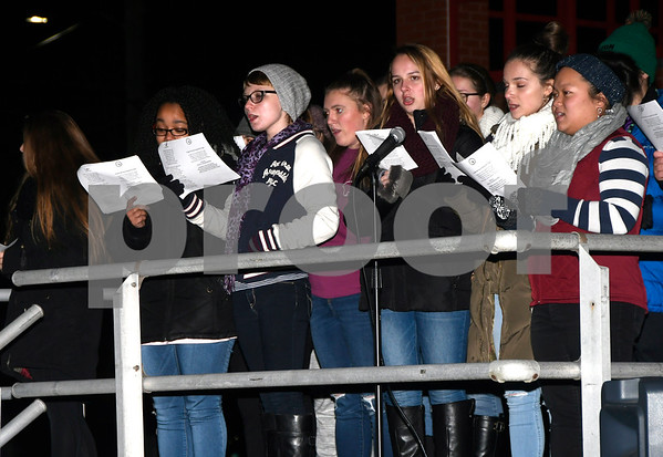 12/8/2017 Mike Orazzi | Staff Members of the Plainville High School Band and Chorus Carol Sing-A-Long during the annual tree lighting held at the Plainville Fire Department Friday evening.